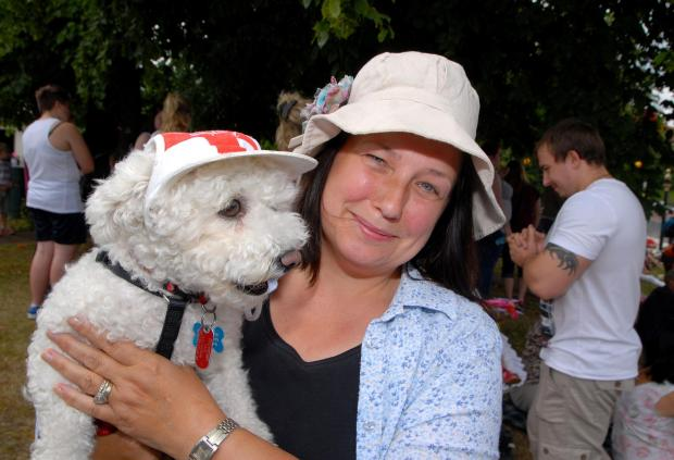 Worcester News: 2814648901 Paul Jackson 12.07.14 Malvern Malvern Carnival at Barnards Green. Marie Cheshmehdoost with Korki a Bichon Frise with their hats on. (8162833)