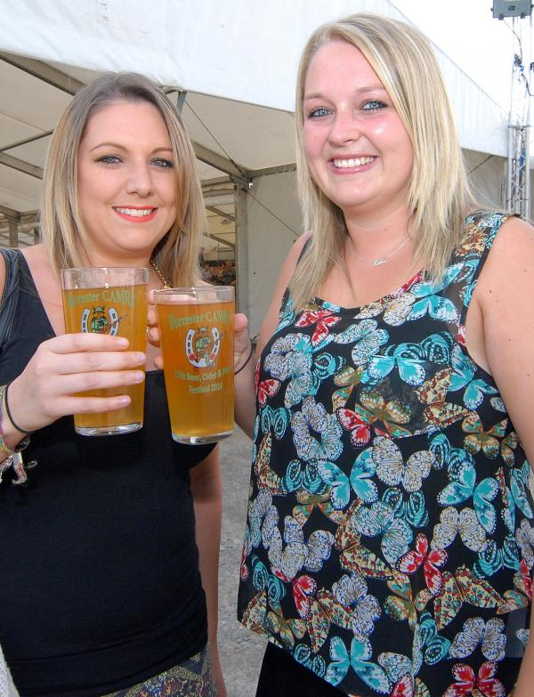 CHEERS: Shelley Gunnell, left, and Kate Wood at the Worcester Beer Festival 2014. Picture by Nick Toogood. 3214671201