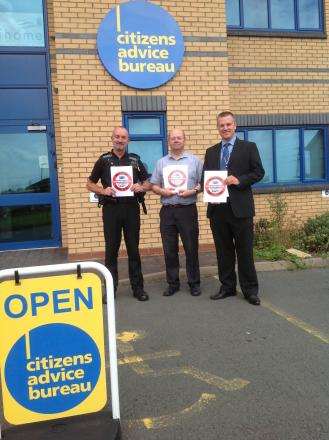 UNDERWAY: Sergeant Ian Blanchard, Richard West and Adrian Symonds of West Mercia Police at the press conference outside Malvern Citizen's Advice Bureau
