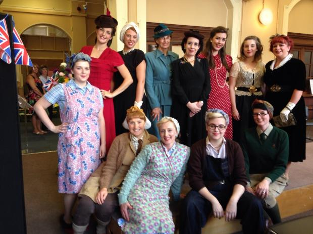Models of 'Puttin' On the Blitz' including organisers Clare Bridge and Jo Bourke (bottom left and bottom right) as Land Girls and compere Suz Winspear, centre.