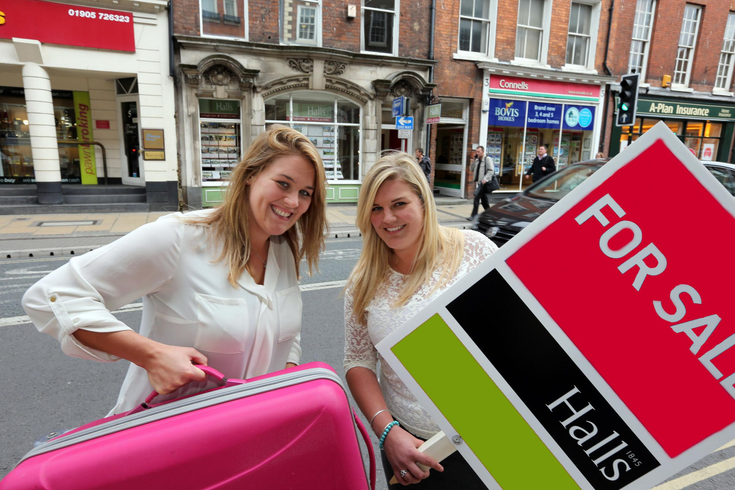 MOVING: Stephanie Doolittle (left) and Demi Owen of Halls Worcester residential team pack for the move.