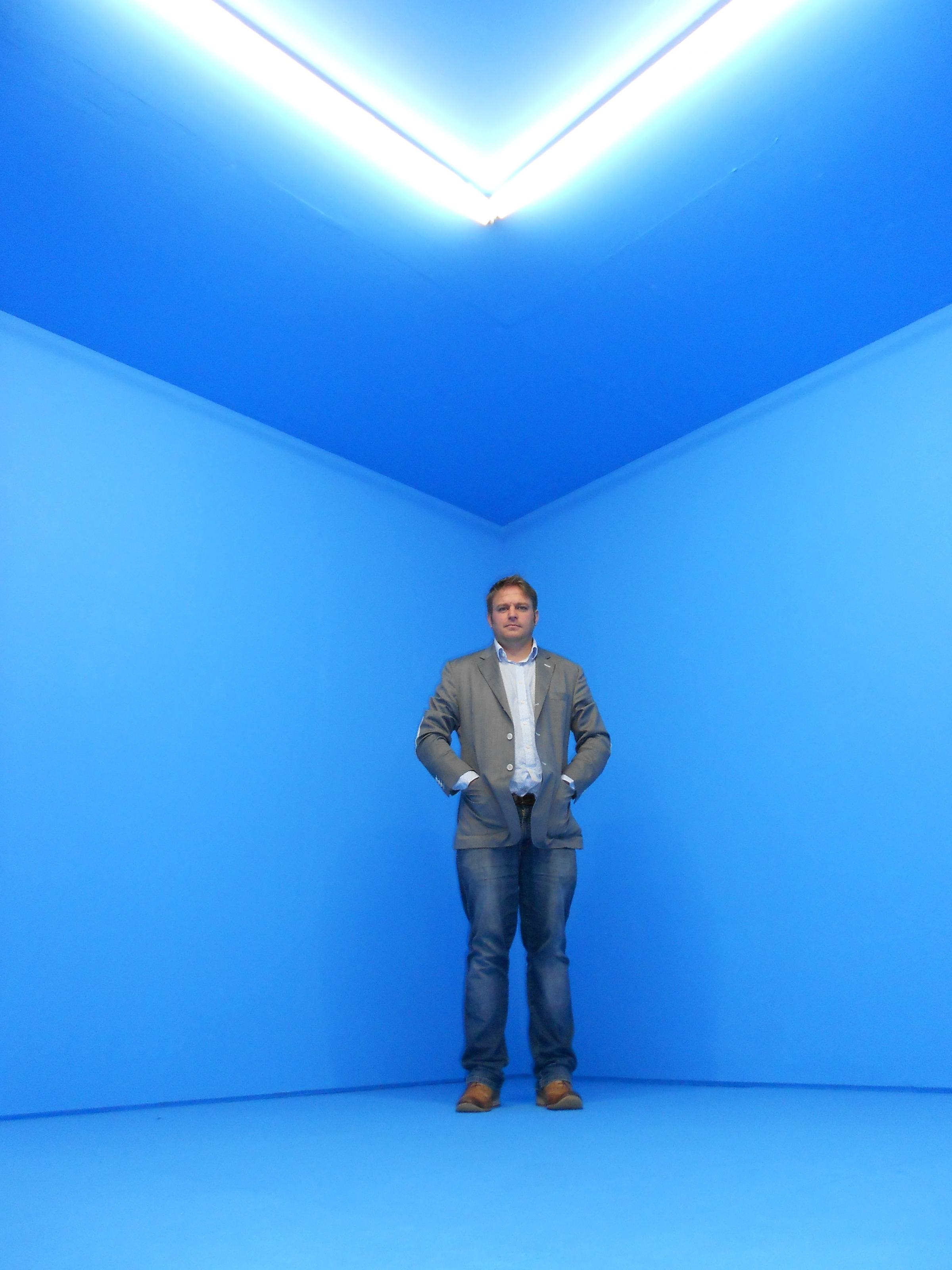 Feeling blue: Nathaniel Pitt stands inside the exhibition Objectless Expansion - a room that has been painted completely cyan - which opens on Saturday.