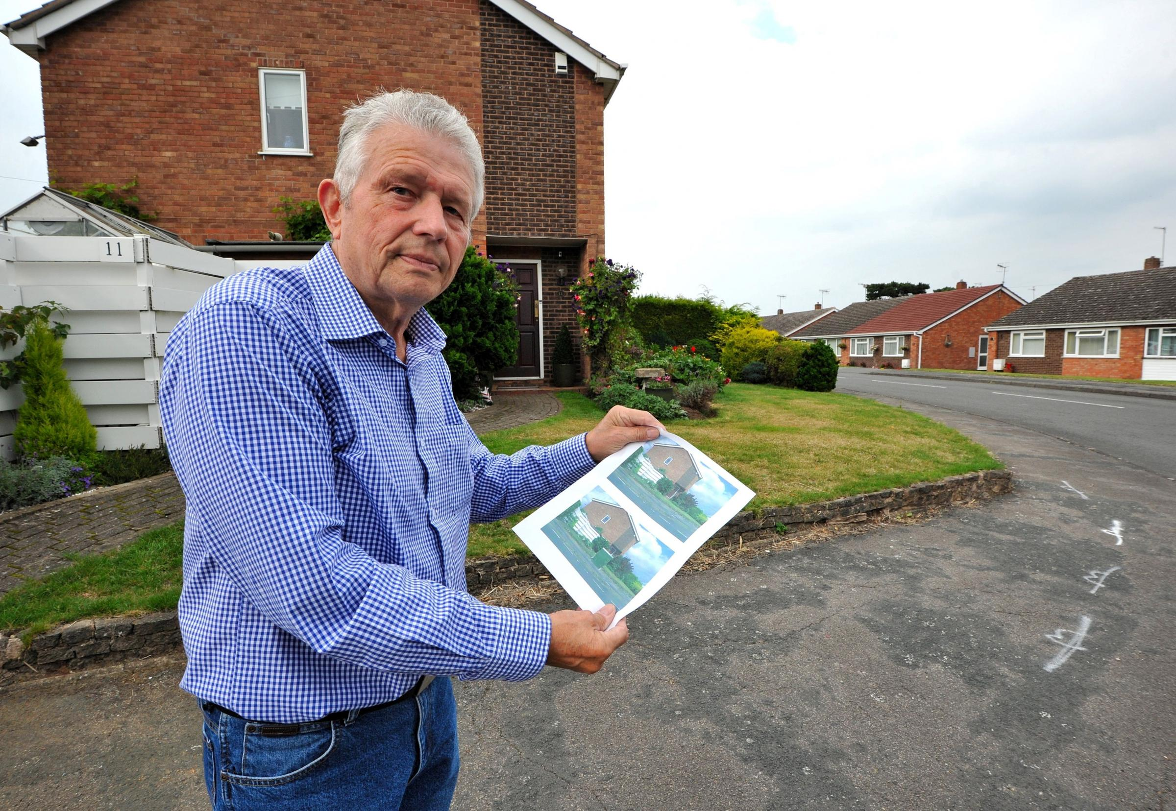 John Anyon       03/09/14             3614691401  Tony Denny from Brookend Lane, Kempsey with an artists impression of what a large BT fibre optic box would look like in fron of his house. Tony is concerned for road safety as the box would be a visual haz