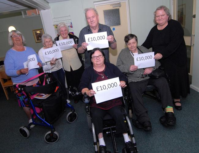 3814700101. 15/09/14. Members of the disabled group from Russell House sheltered accommodation celebrating their £10,000 grant. Left to right - Jenny West, Catherine King, Val Wren, Mick Auty, chairman Ann Marden, Margaret Smith and Sue Stallard. Pi