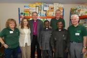 VISIT: Volunteers at the Worcester foodbank alongside the international visitors.