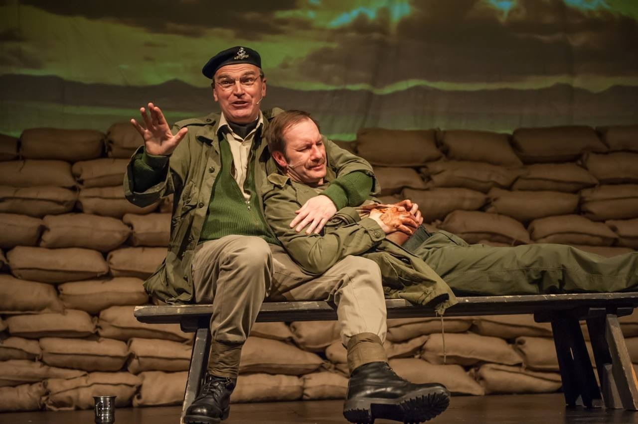 COMFORT: Woodbine Willie, played by David Robinson (seated), tends wounded soldier Michael Taylor