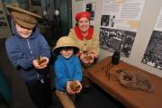 John Anyon     8/11/14      4514749001  Discover History exhibition at Worcester City Art Gallery and Museum on Saturday as part of Family Remembrance Activities.................Helen Lee from Discover History with brothers, Ellison Bean, 8 and Samual Bea