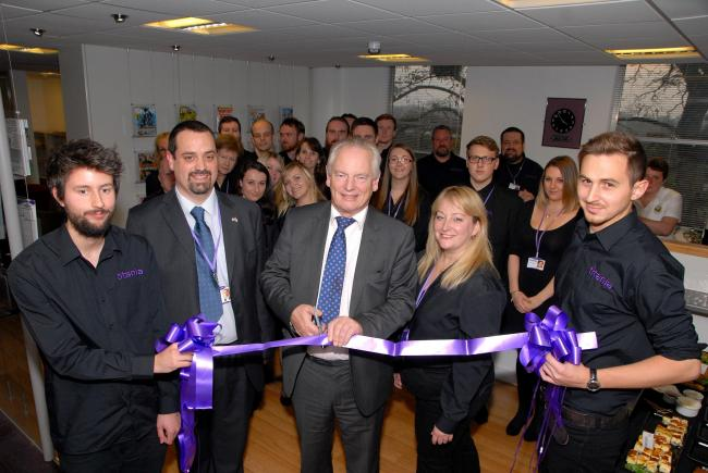 The opening of Titania's new offices in Worcester - Francis Maude, Minister for the Cabinet Office and Paymaster General cuts the ribbon with Ian Whiting, CEO and Nicola Whiting