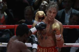 Mickey Rourke got back in the boxing ring - and beat a man half his age