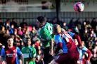 Jordan Murphy battles for the ball against Scunthorpe United in the FA Cup. Picture: JONATHAN BARRY.