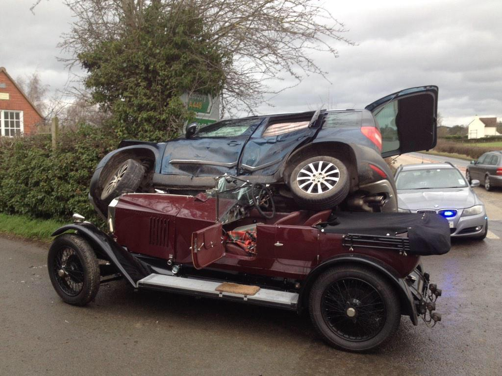 Dramatic pictures as vintage car crash traps man and woman ...