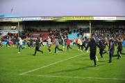 INVASION: Fans run onto the pitch after City's FA Cup second round match at Scunthorpe United.