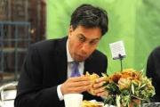 BACON: Ed tucking into his infamous bacon sandwich. Does he like curry?