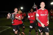 Kidderminster Harriers players with the trophy. Picture: DAVID GRIFFITHS.
