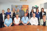Cargill's global CEO David MacLennan, back centre left, meets staff at the company's Hereford headquarters.