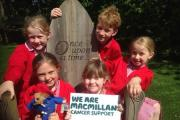 Members of the school council with Poppy Hewitt holding a Macmillan sign and Paddington Bear. SP (24818844)