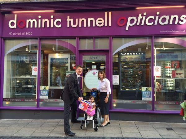 DONATIONS: Dominic Tunnell collects the donation buckets from Georgie and Clare Gibbs. People can now make donations inside the optician's on Mealcheapen Street (s)