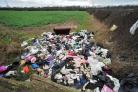 SHOCKING: Fly tippers have dumped piles of rubbish, including a sofa, on farmland next to the B4636, close to the M5 Motorway stretch near Warndon.Picture by Jonathan Barry.  0516002008