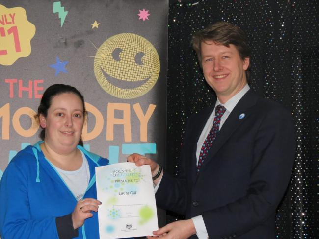 Laura Gill, 28, from Leigh, was named a Point of Light by Prime Minister David Cameron for her voluntary work in the community. She was presented with the award by Worcester MP Robin Walker (pictured)