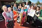 Melissa Jones (front) and fifteen month old son Matthew Jones, with campaigning parents and children at Cornmeadow Early Years and Families, Worcester. Picture by Jonathan Barry