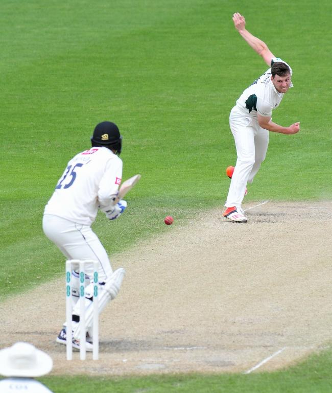 Bowler Matt Henry sends down a delivery.