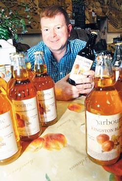 Worcester News: Richard Reynolds  of Barbourne Ciders, with bottles of his cider    in the food and drink village. Picture by Simon Rogers. 24425312
