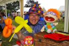 FETE FUN: Reverend David Sherwin with puppet, Chuckie, at Wichenford Village Fete. Picture by John Anyon.