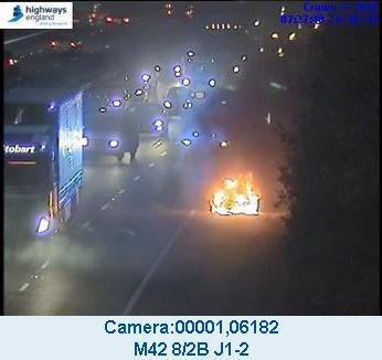A car caught fire on the M42 southbound. Picture by Highways England.