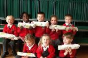 Pupils from Dines Green Primary with the bread donated to them by Subway