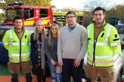 Lucie Kirkham, Lydia Morris and Callum Perry with members of Hereford and Worcester Fire and Rescue Service