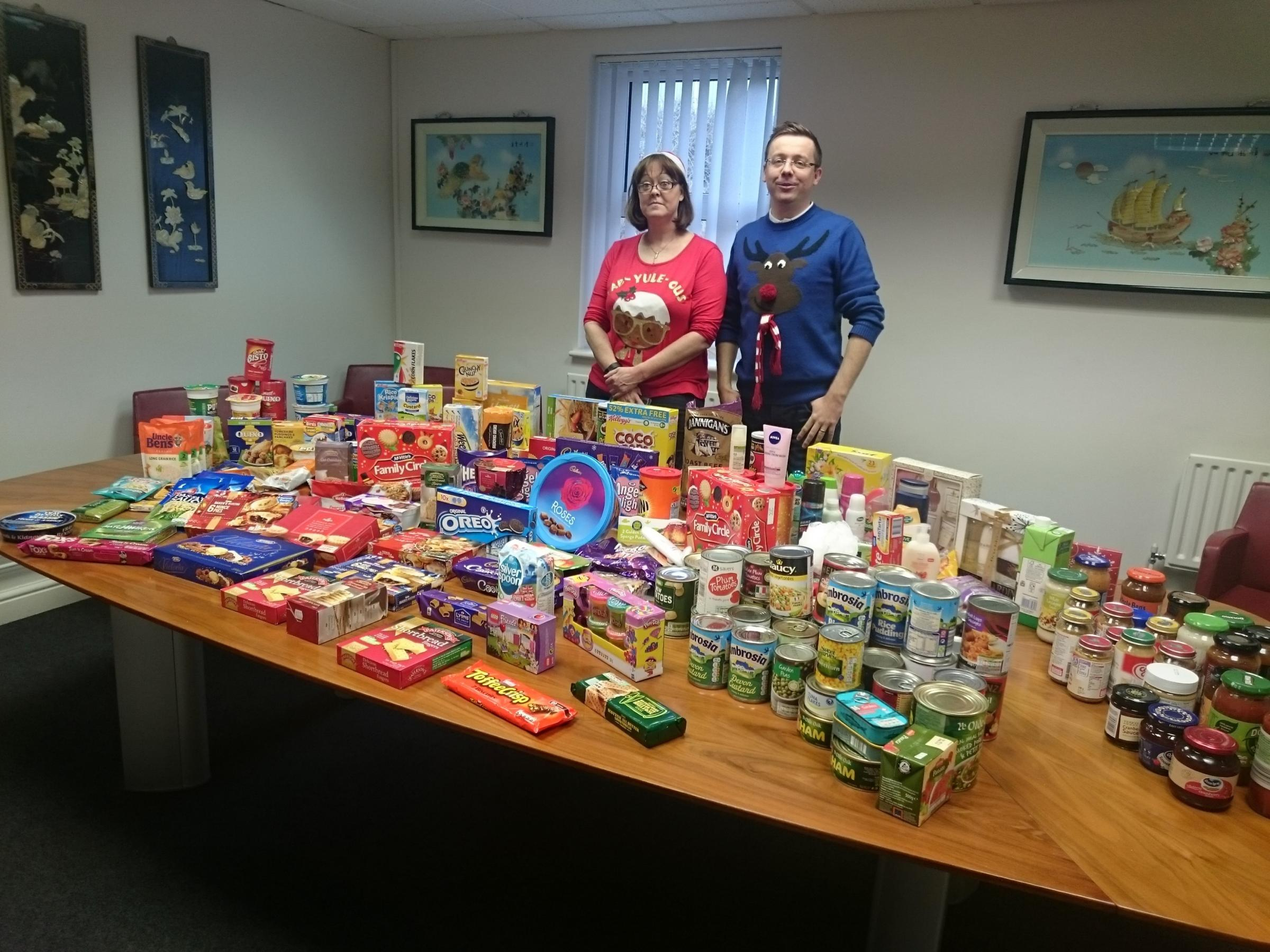 DONATIONS: Secretarial services manager Claire Selman and Alex Dyer, partner at Ormerod Rutter with items donated to the food bank