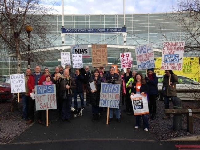 PROTEST: Members of 38 Degrees make their feelings known outside Worcestershire Royal Hospital in Worcester on Saturday.
