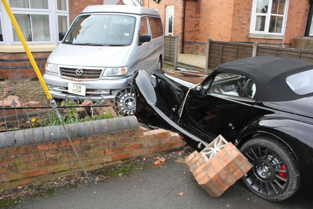 VIDEO: Morgan sports car written off after crashing through wall and ...