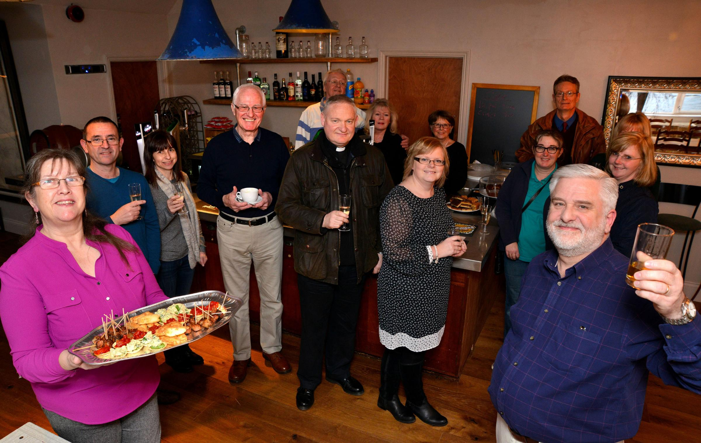 The opening of the new coffee and lounge bar at Norton Juxta Kempsey Parish Hall. Chairman of parish hall trustees, Kevin Fincher with guests toast the opening of the new facility. Photo by John Anyon