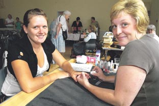 FEELING GOOD: Vicky O'Dwyer gets a manicure from Michelle Price at the Fairfield Centre. Picture by Simon Rogers. (31471403)