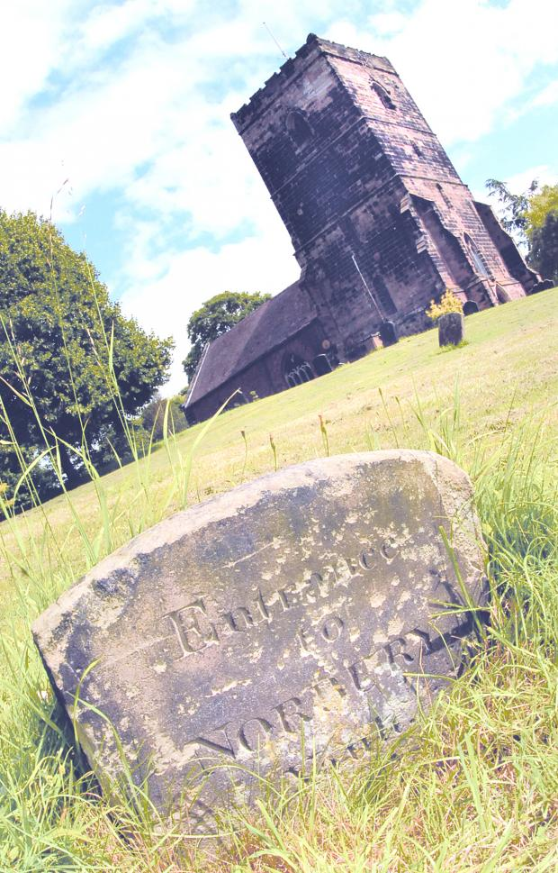 Mysterious: This stone in the churchyard has sparked a debate between residents over the town's secret tunnel myth.