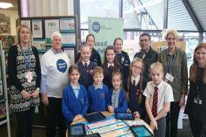 Julie Herbert, Chawson's ICT lead, with pupils and staff from Westacre Middle School, Chawson First School and representatives from West Mercia Police and South Worcestershire Citizens Advice