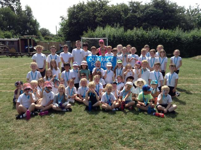 Children at Upton Snodsbury CE First School raised more than £100 by organising a Race for Life event