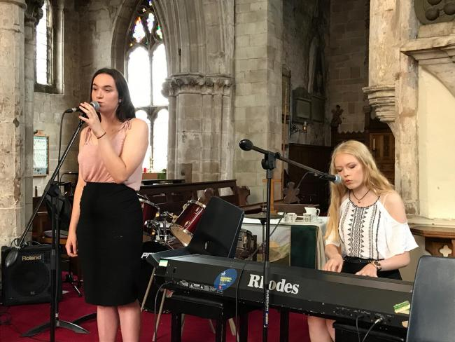 Charlotte Mortimer (left) and Eleanor Bradley of Droitwich Spa High School performing in St Andrew's Church
