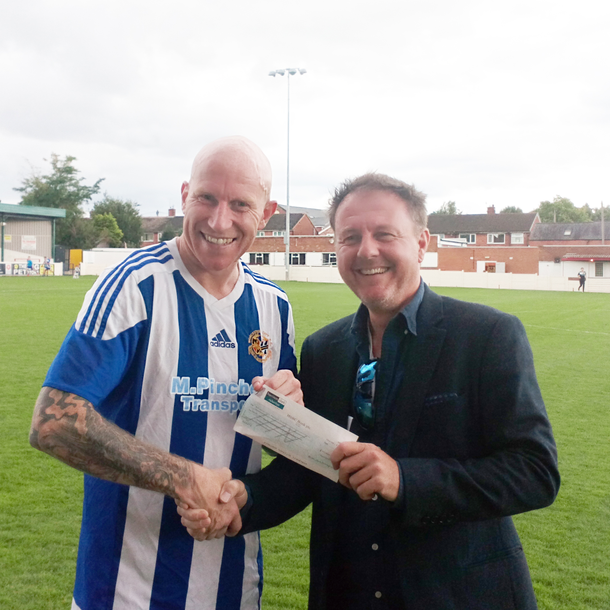 SPONSORSHIP: : Kevin Harris-James presents sponsorship funding to Lee Hughes.