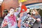JOIN US: Zombie Mike Smith and Andy and Tracey Monaghan prepare for the Worcester Zombie Walk. Picture: John Anyon. (41037801)