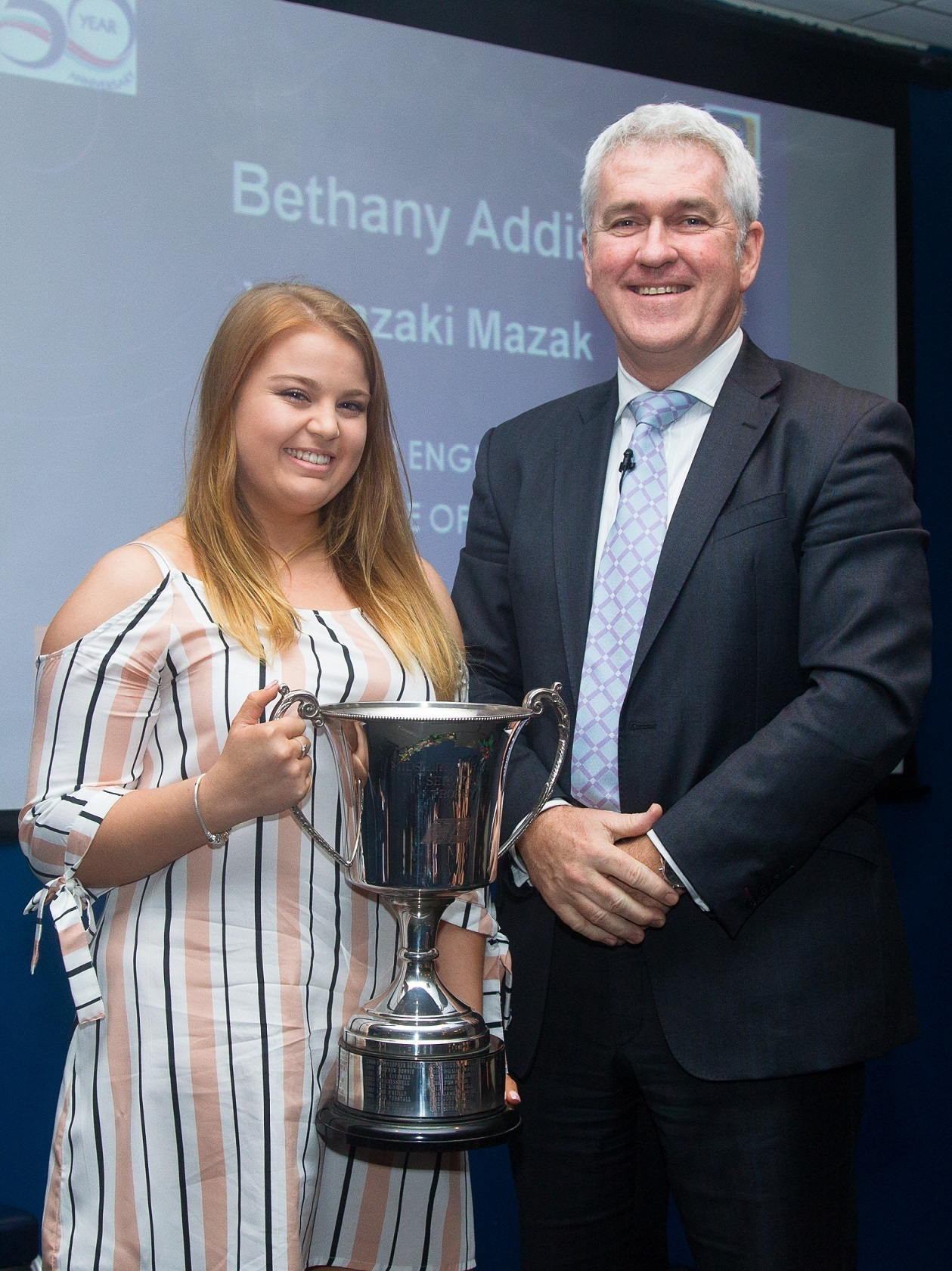 AWARD: Beth Addis from Mazak receives her award. Picture: Kevin Baldwin