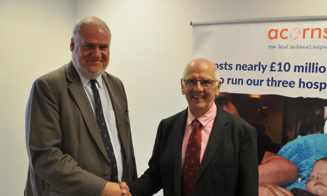 NEW CHAIRMAN: Mark Hopton with outgoing chairman David Butcher.