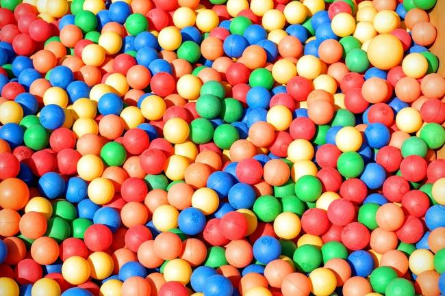 The novelty event features adults drinking Prosecco in ball pits. Pixabay