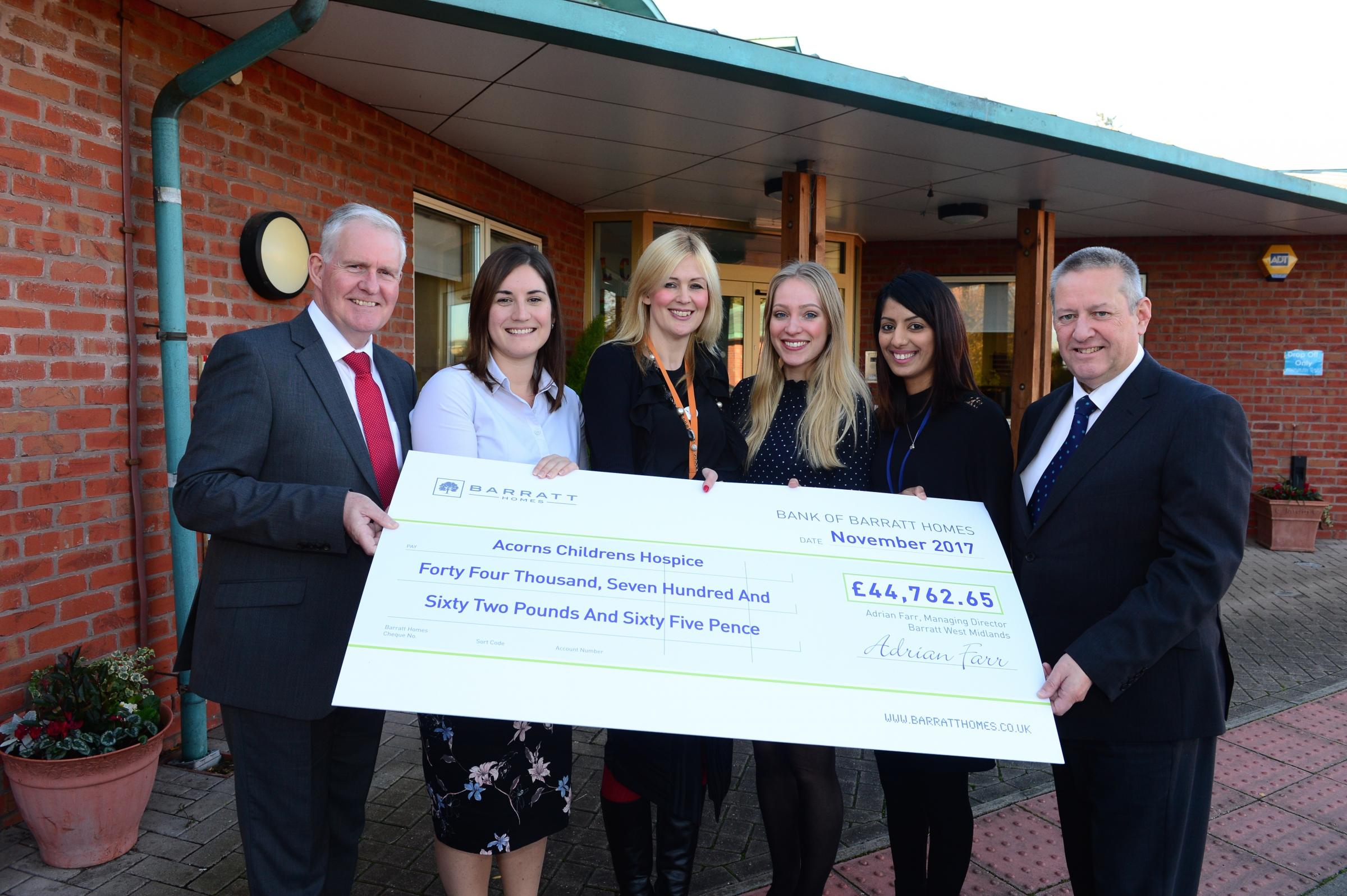 DONATION: Barratt Homes staff awarding the cheque to Acorns Children's Hospice