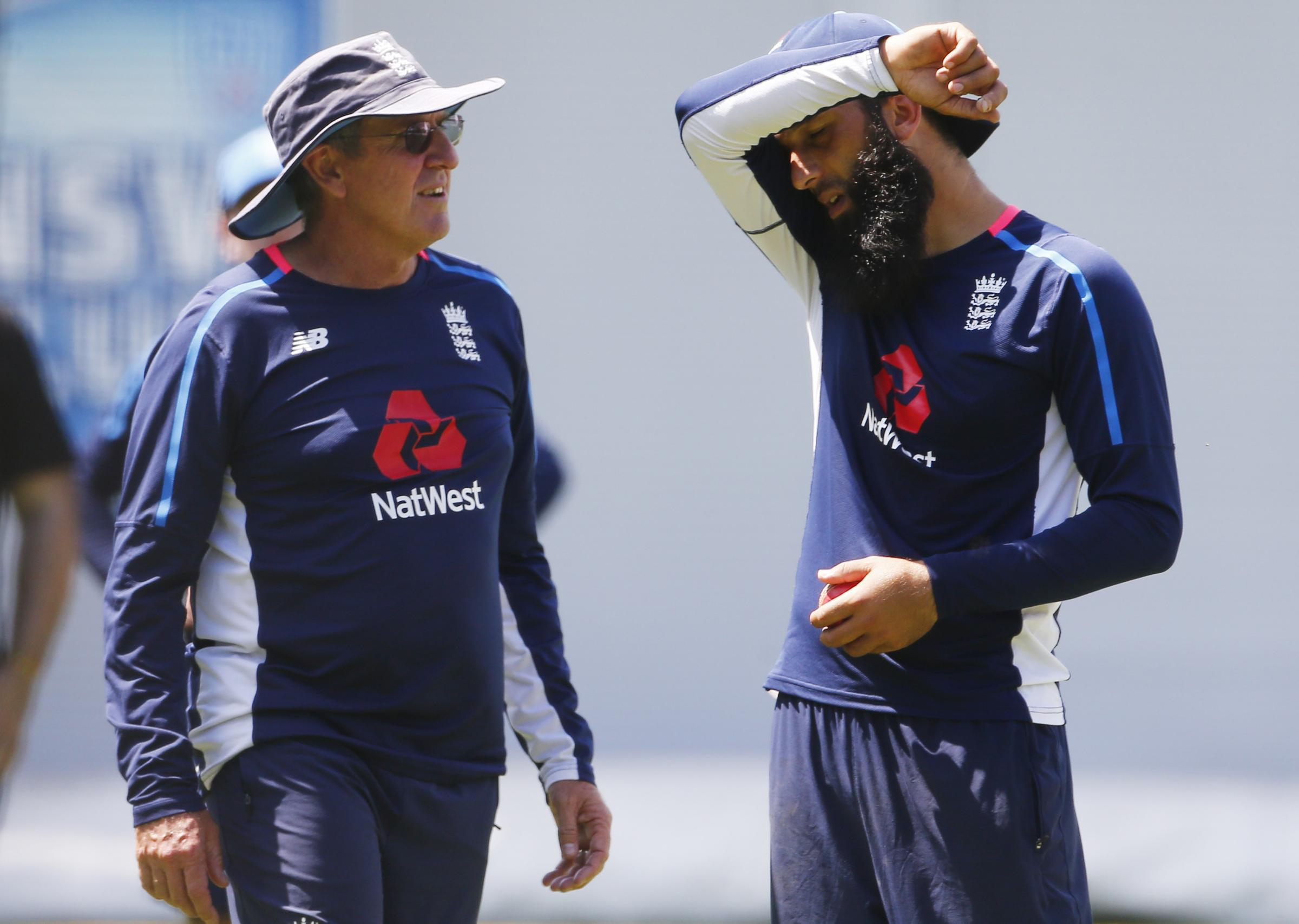England's and Worcestershire's Moeen Ali talks with coach Trevor Bayliss during a nets session in Sydney. Picture: JASON O'BRIEN/PA WIRE