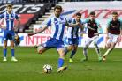 Will Grigg scored twice as Wigan dumped West Ham out of the FA Cup (Anthony Devlin/PA)