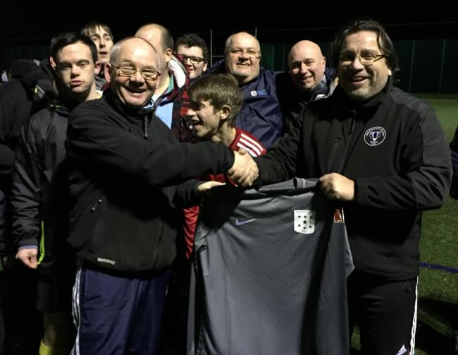 4ac90a166 Leigh and Bransford Badgers president Bosco Medakovic hands over the new kit  to Worcester Disability FC