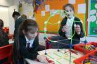 Youngsters at St Joseph's have a go at designing and building a pedestrian bridge for Worcester