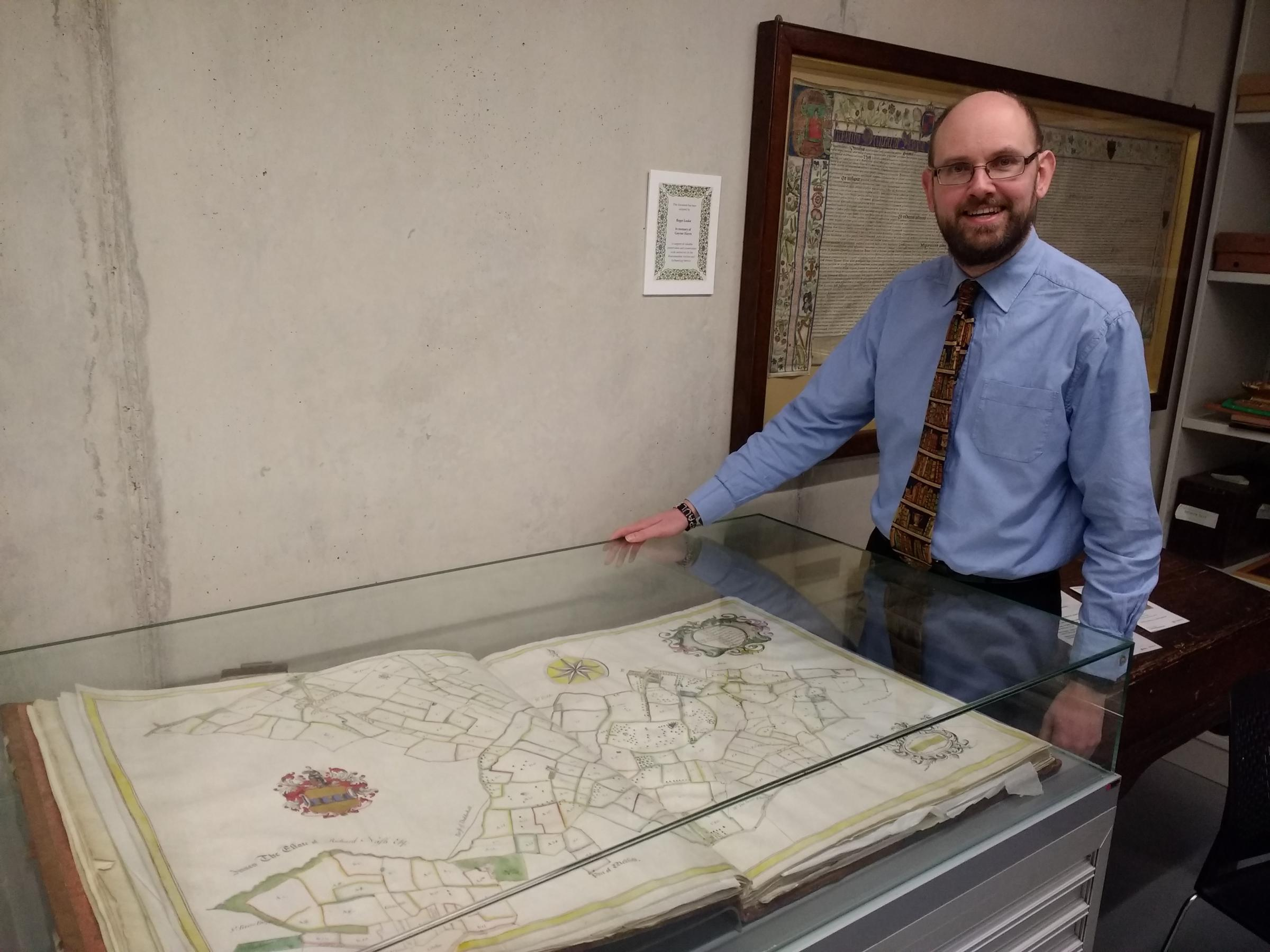 Paul Hudson with the 1732 Vernon map book at The Hive